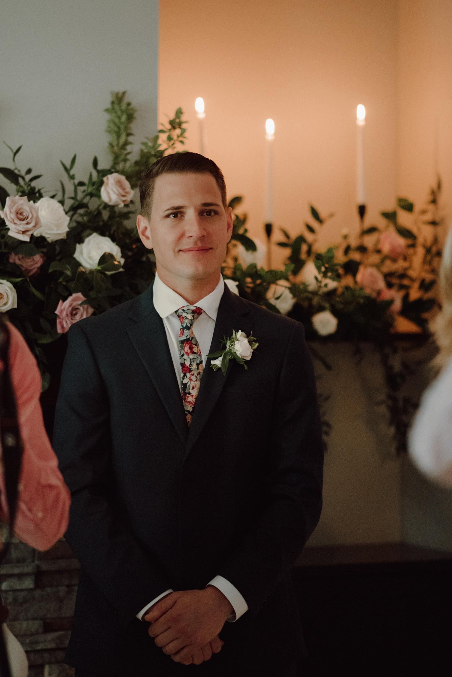 groom looking at bride minneapolis in home wedding