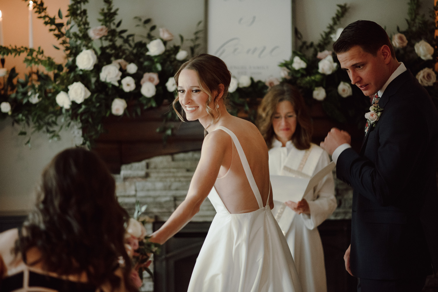 bride and groom during in home intimate wedding ceremony minneapolis