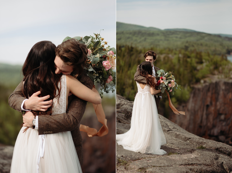 bride and groom hugging over clifside
