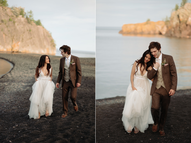 bride and groom walking on black beach north shore minnesota