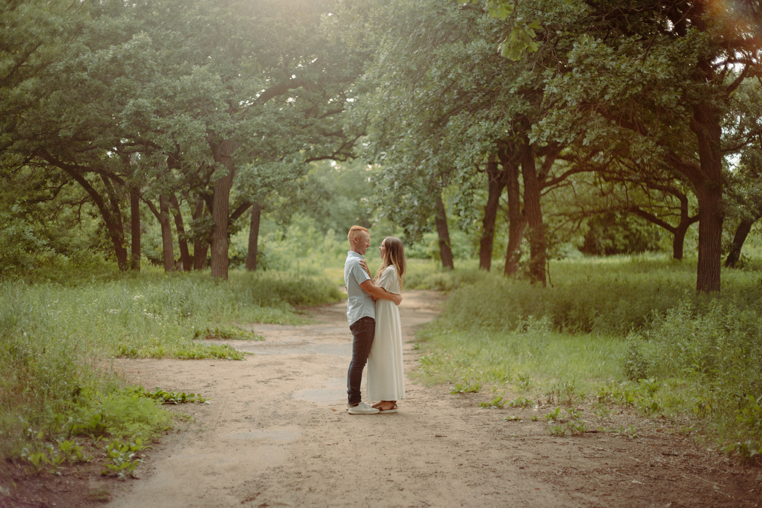engaged couple on dirt nature path minneapolis park