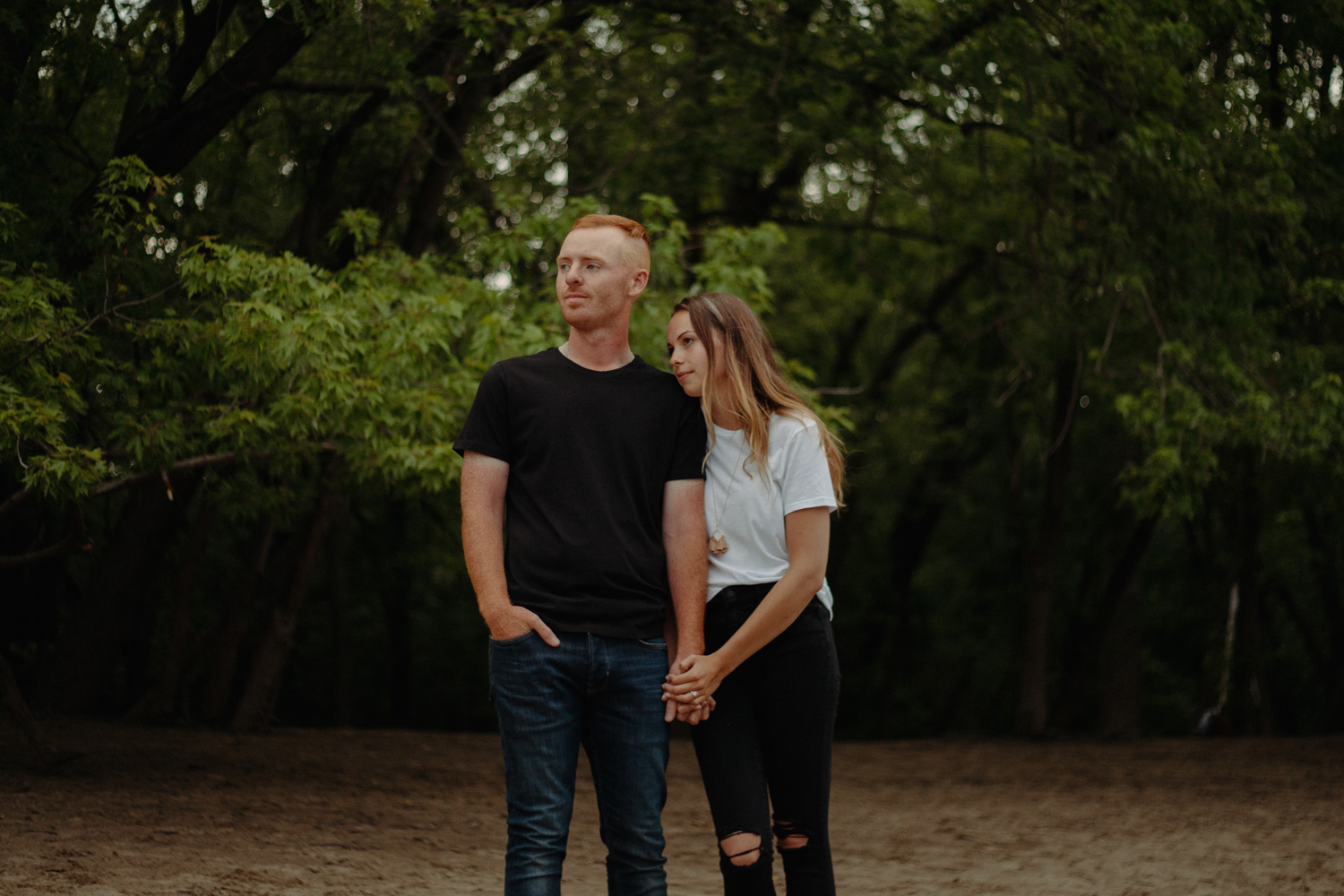 Couple in front of trees on the beach minnehaha river engagement photos