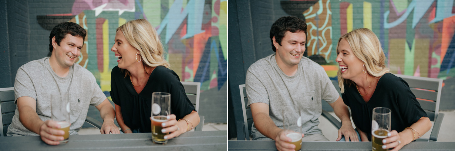 engaged couple laughing at a brewery