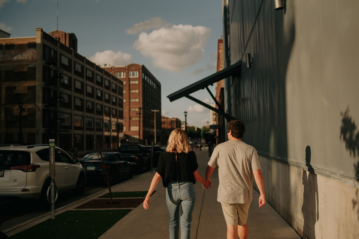 Couple walking during sunset in downtown Minneapolis