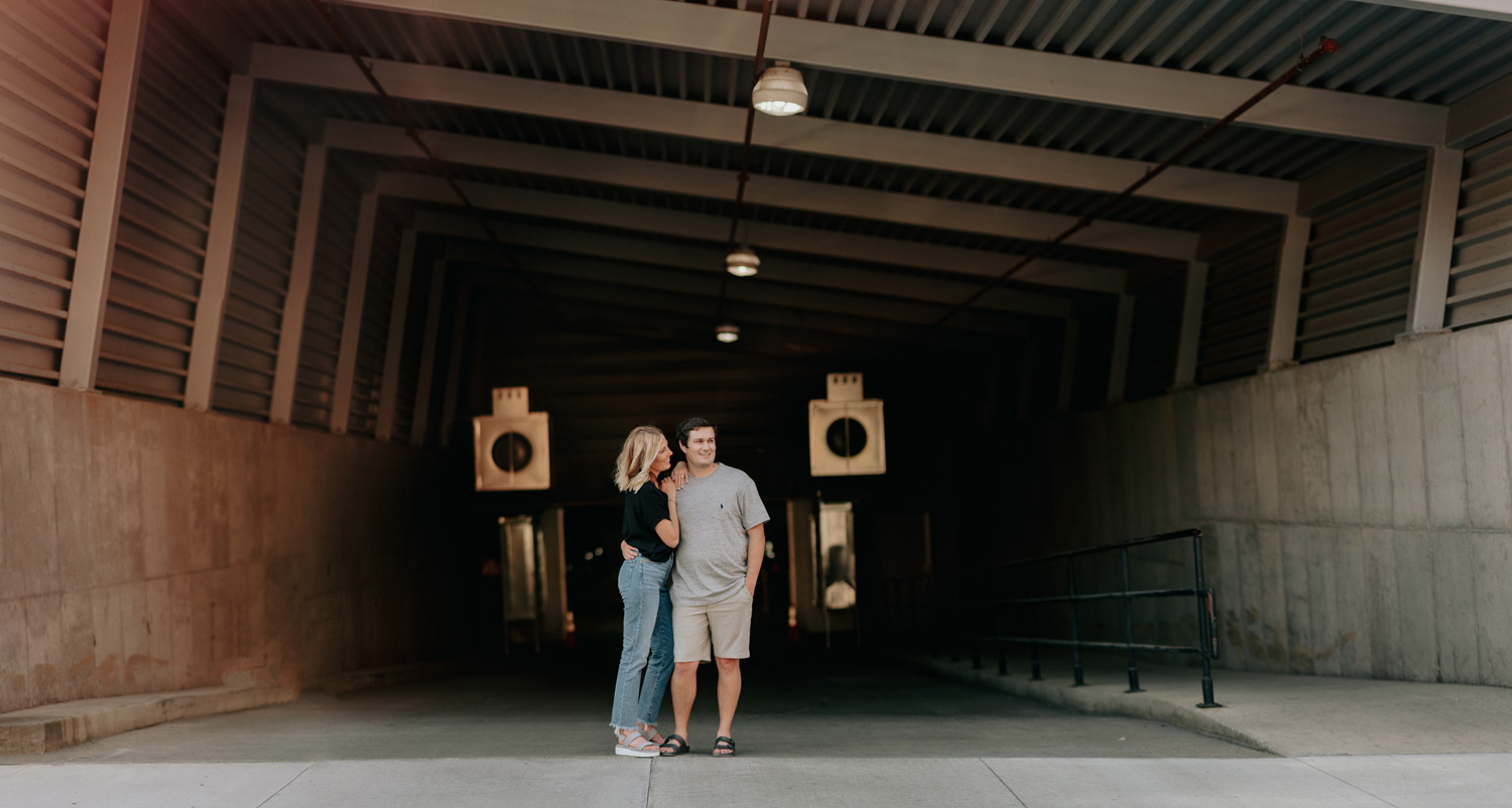 engaged couple in front of parking garage North Loop Minneapolis