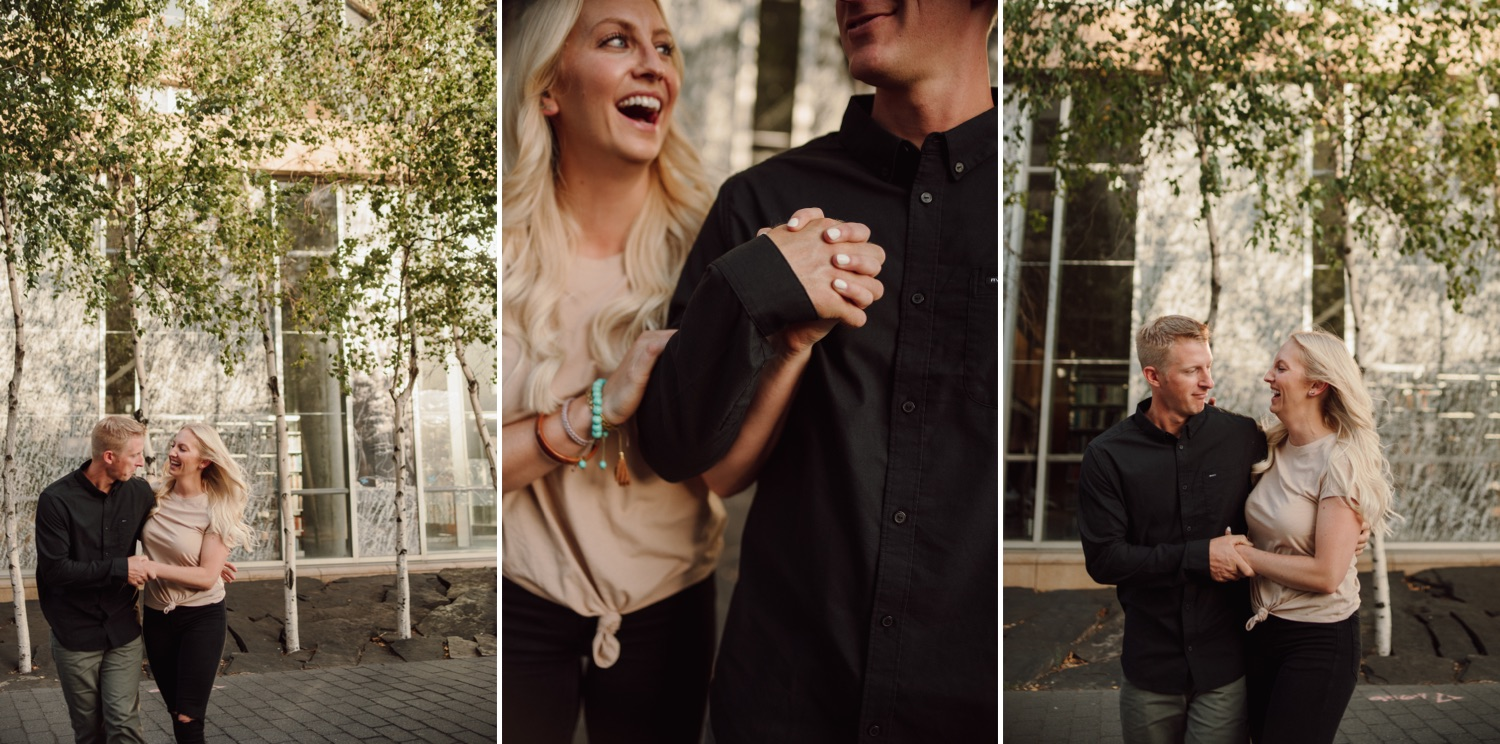 engaged couple laughing and walking downtown Minneapolis photo session