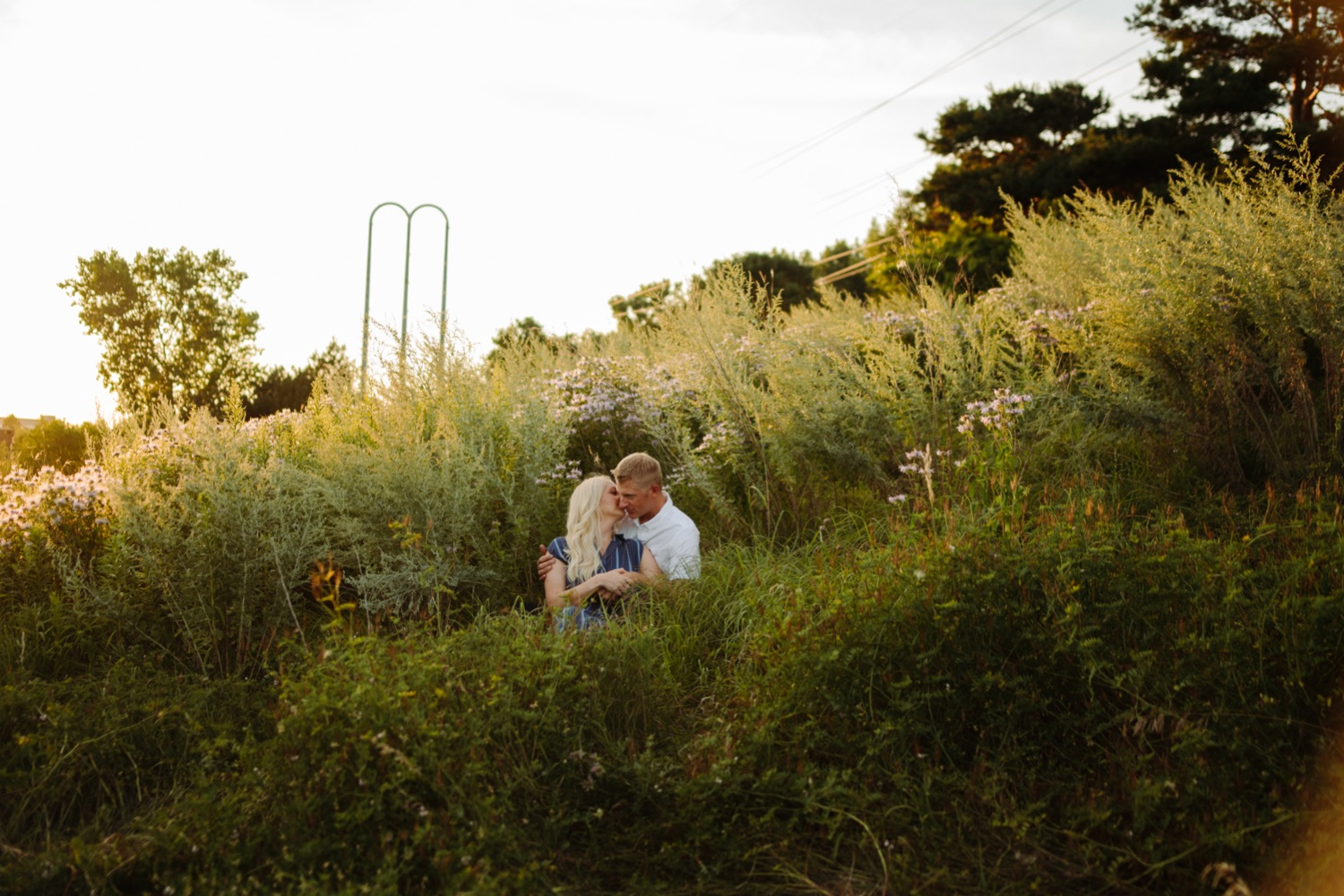 Engaged couple in summer field minneapolis photo session