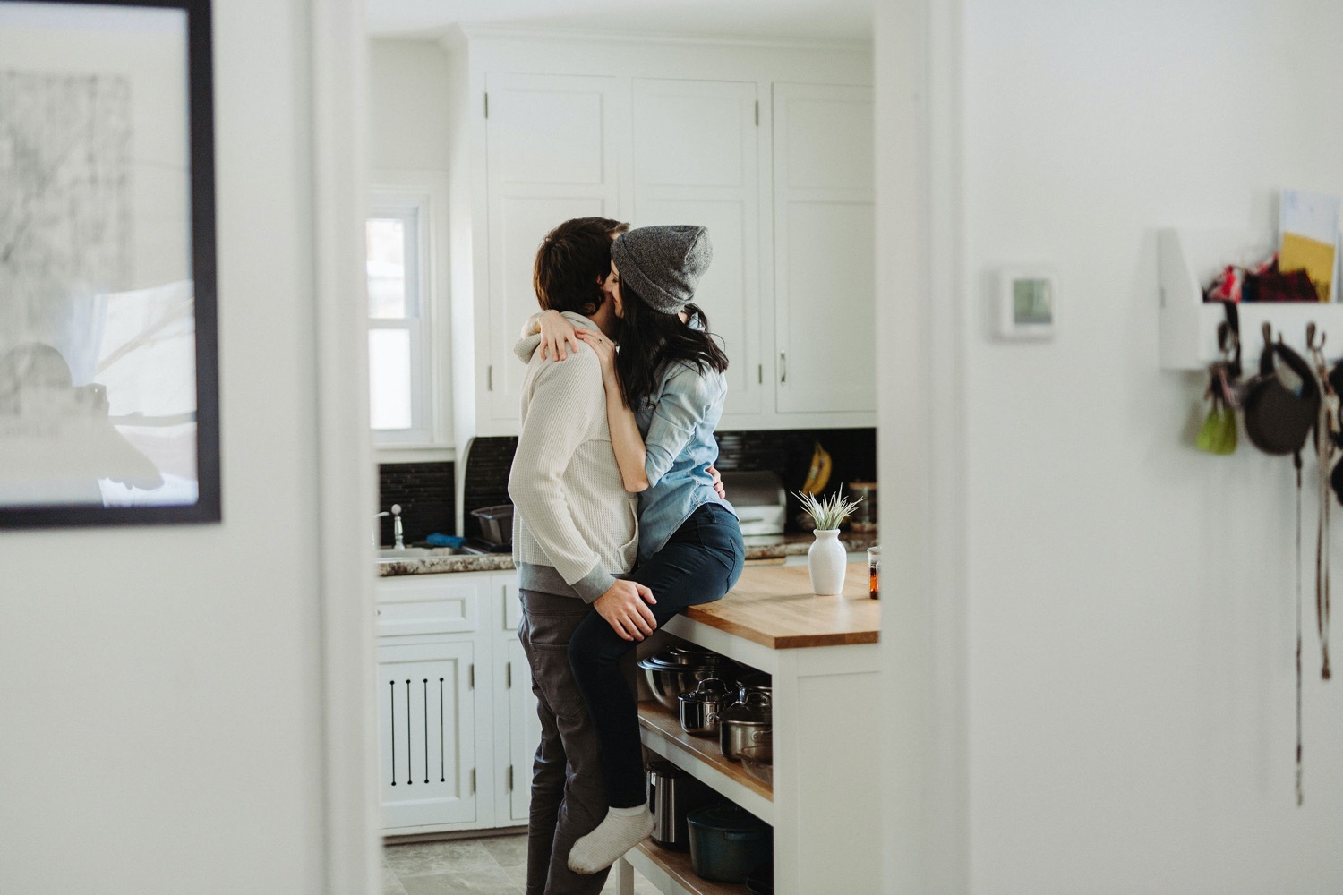 couple cuddling in the kitchen intimate in home session