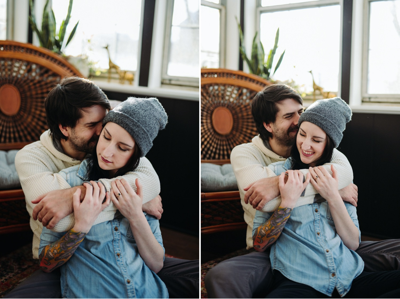 couple cuddling in home sun room