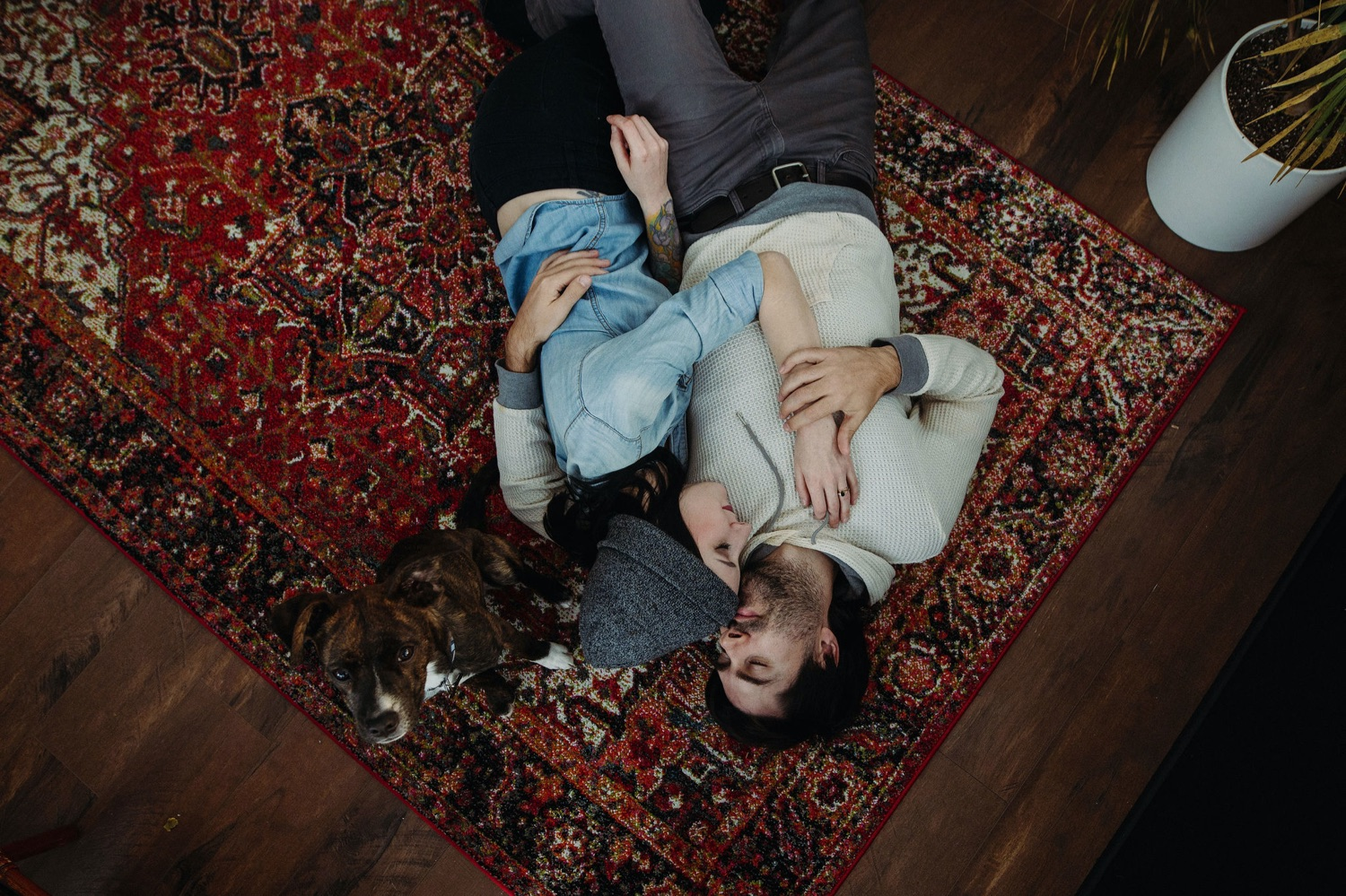 couple cuddling on the floor in home session
