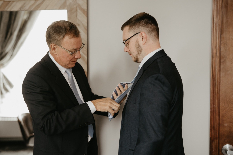 groom getting ready dad helps with tie lumber exchange minneapolis