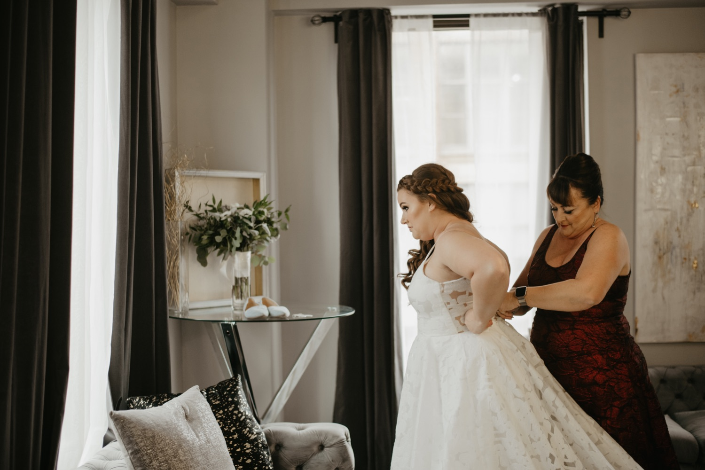 bride putting dress getting ready on lumber exchange minneapolis