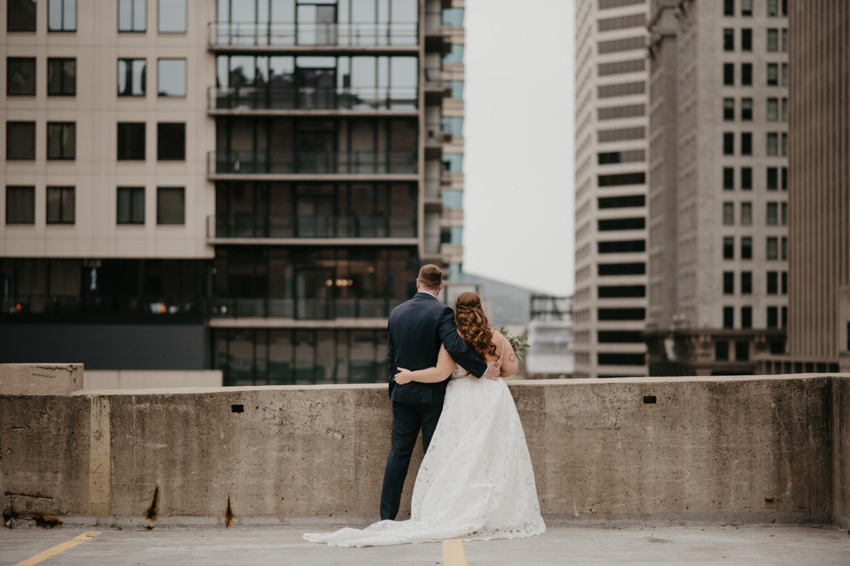 bride and groom looking at the view parking garage rooftop lumber exchange minneapolis