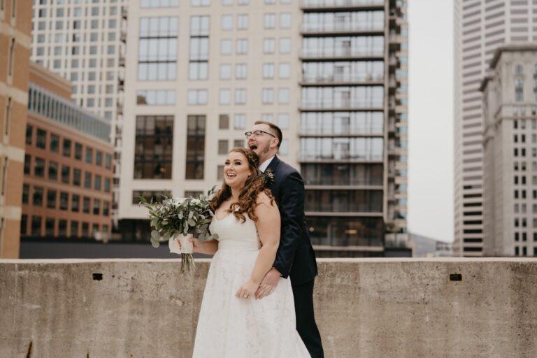 bride and groom laughing parking garage rooftop lumber exchange minneapolis