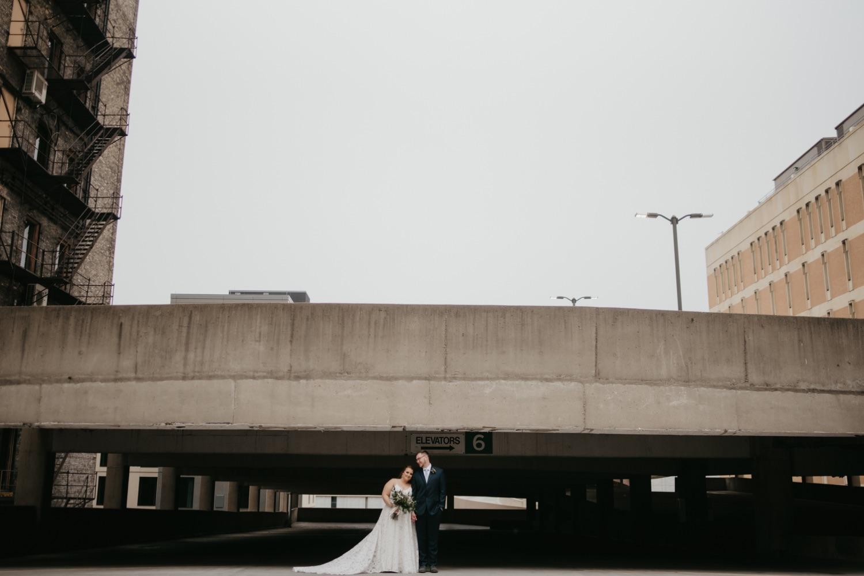 bride and groom long shot parking garage rooftop lumber exchange minneapolis