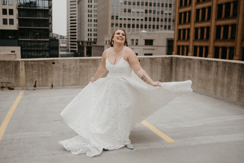 bride twirling in wedding dress parking garage rooftop lumber exchange minneapolis