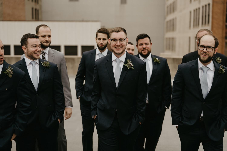 groomsmen walking on a rooftop lumber exchange minneapolis