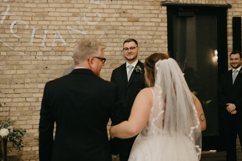 groom sees bride down the aisle lumber exchange minneapolis