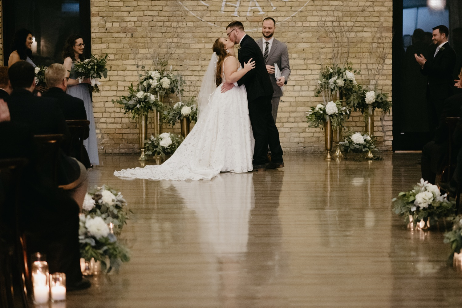 wedding first kiss ceremony with reflection in the floor lumber exchange minneapolis