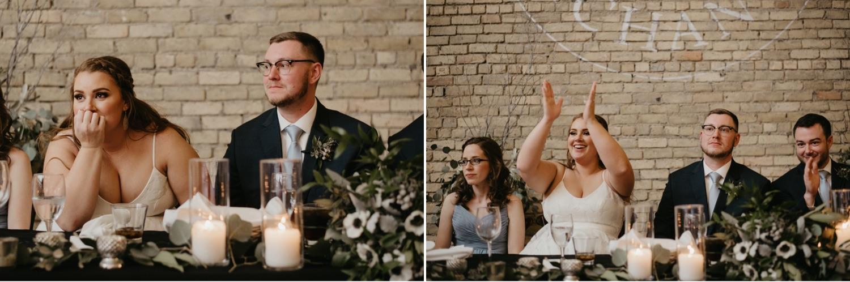 bride and groom during toasts lumber exchange minneapolis wedding