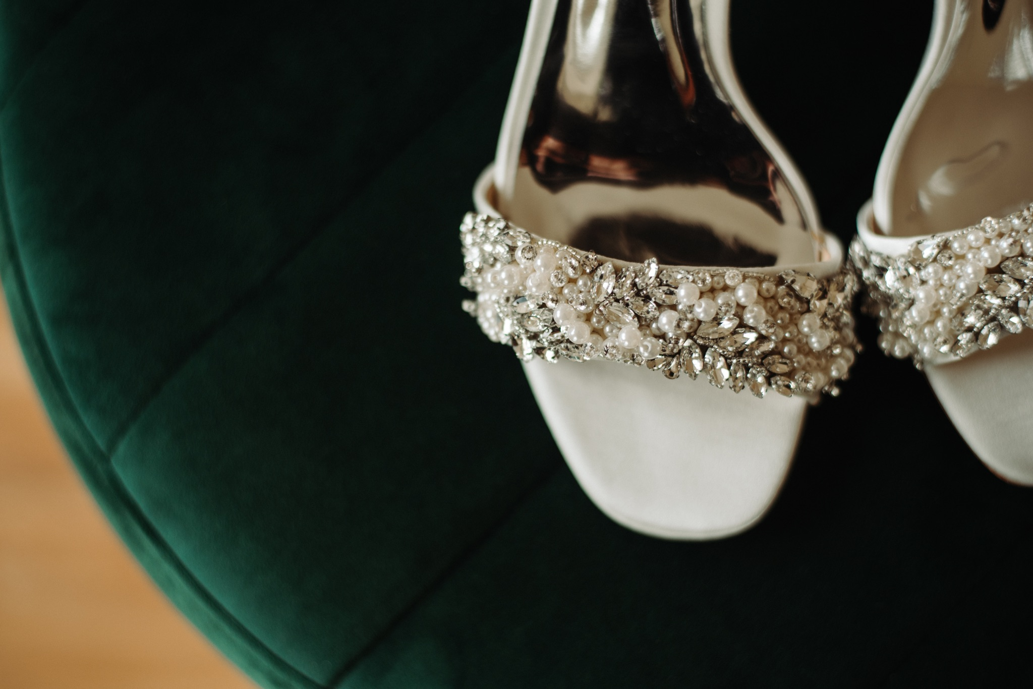 bride's white shoes on green background