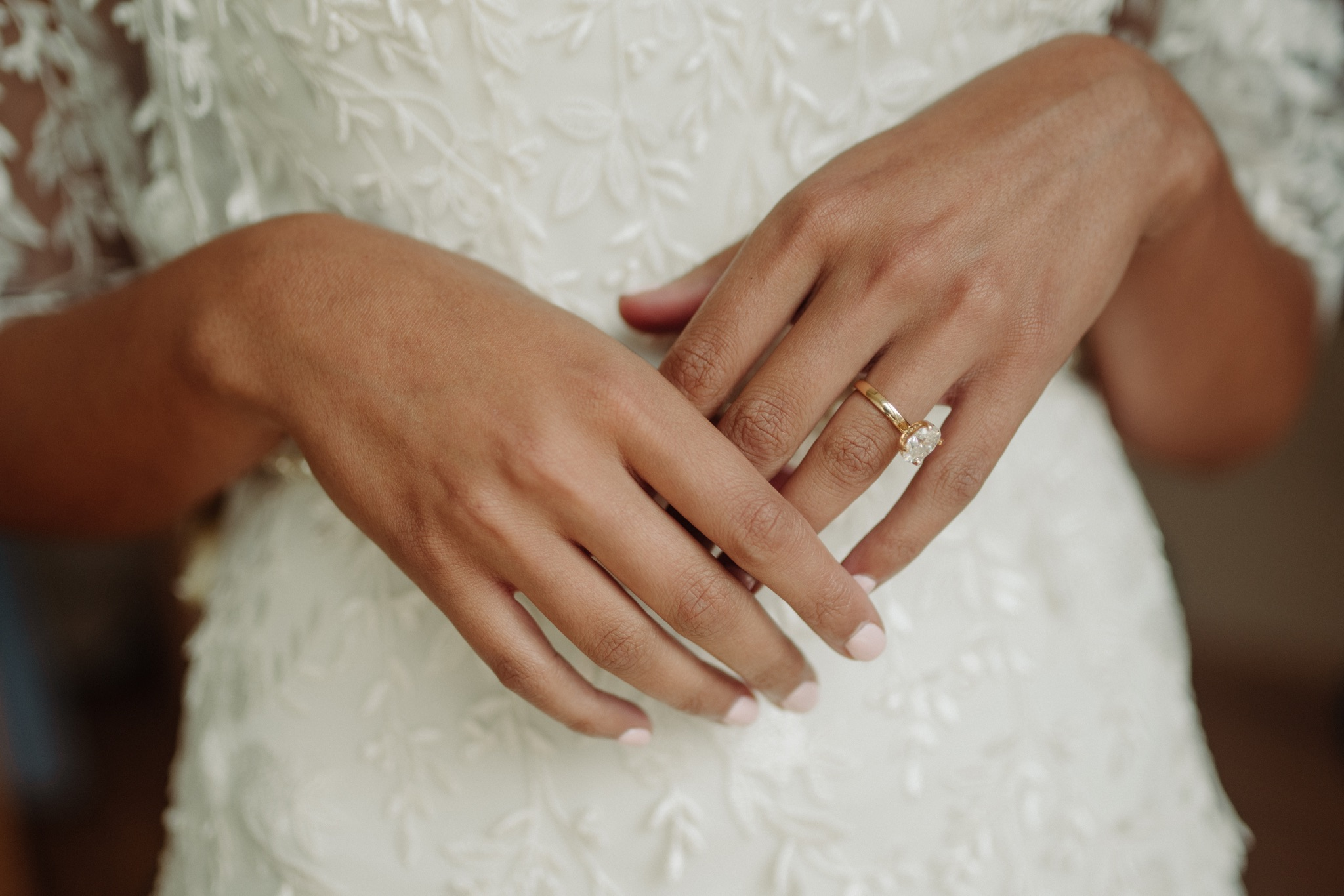 hands crossed with engagement ring on left hand