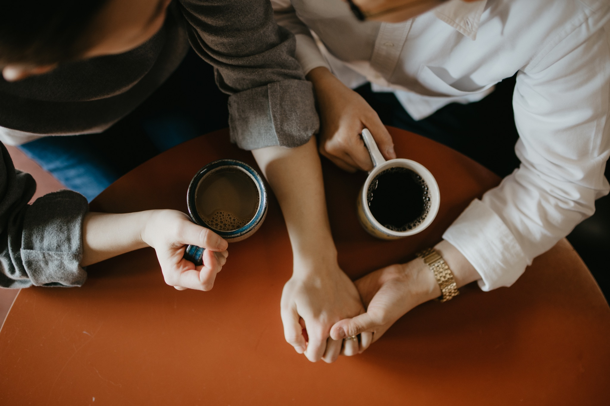 bride and bride's hands and coffee mugs
