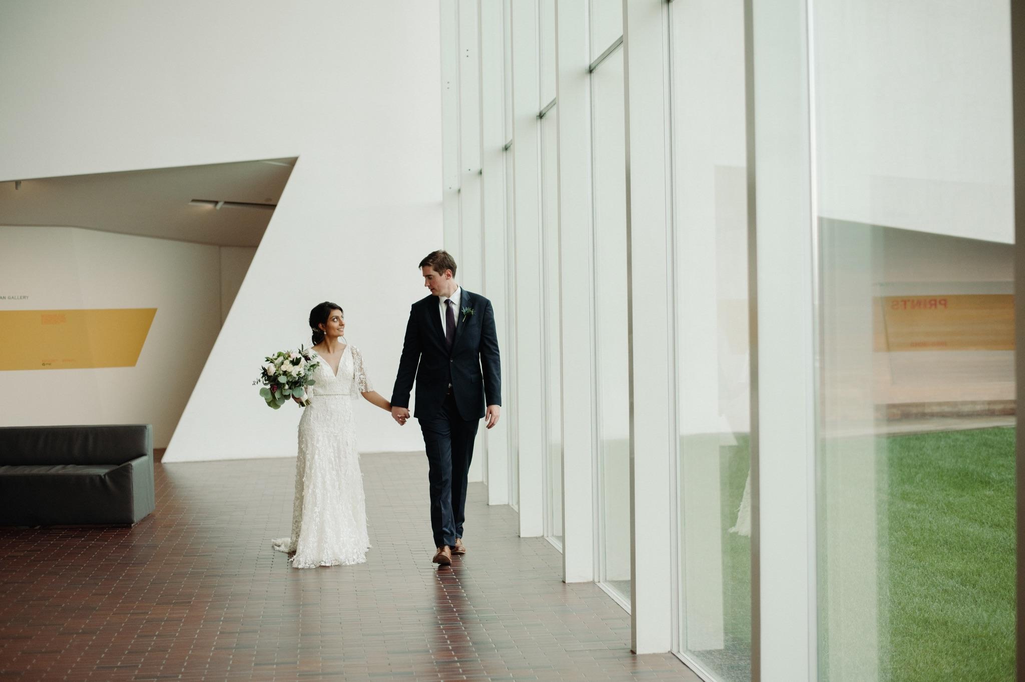 bride and groom walking, white background walker art center wedding