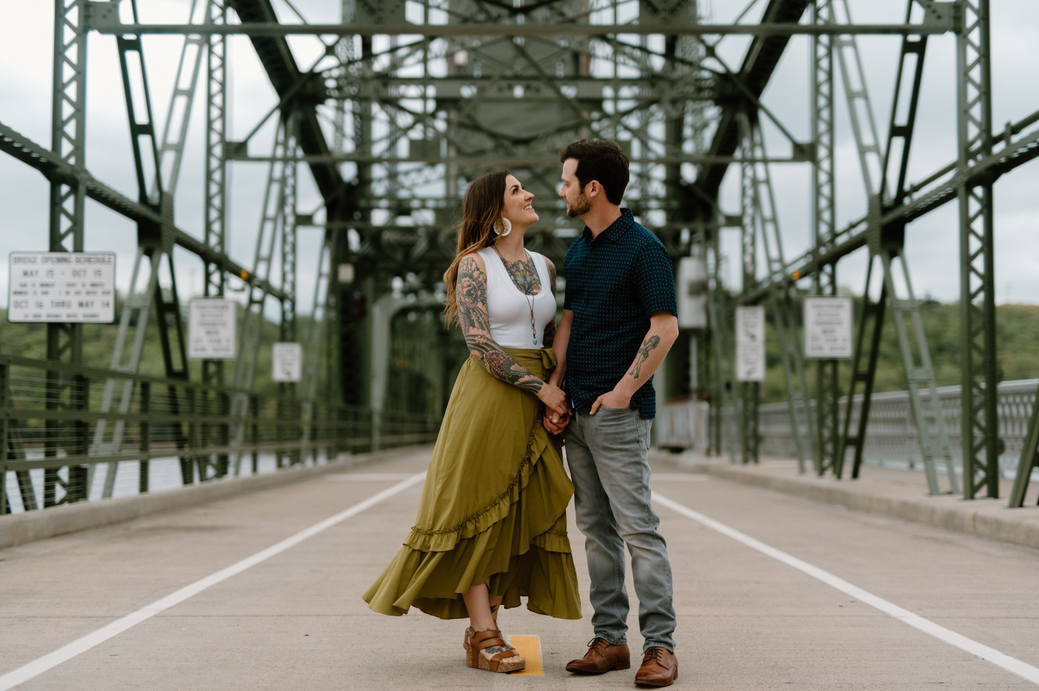man and woman standing on a bridge