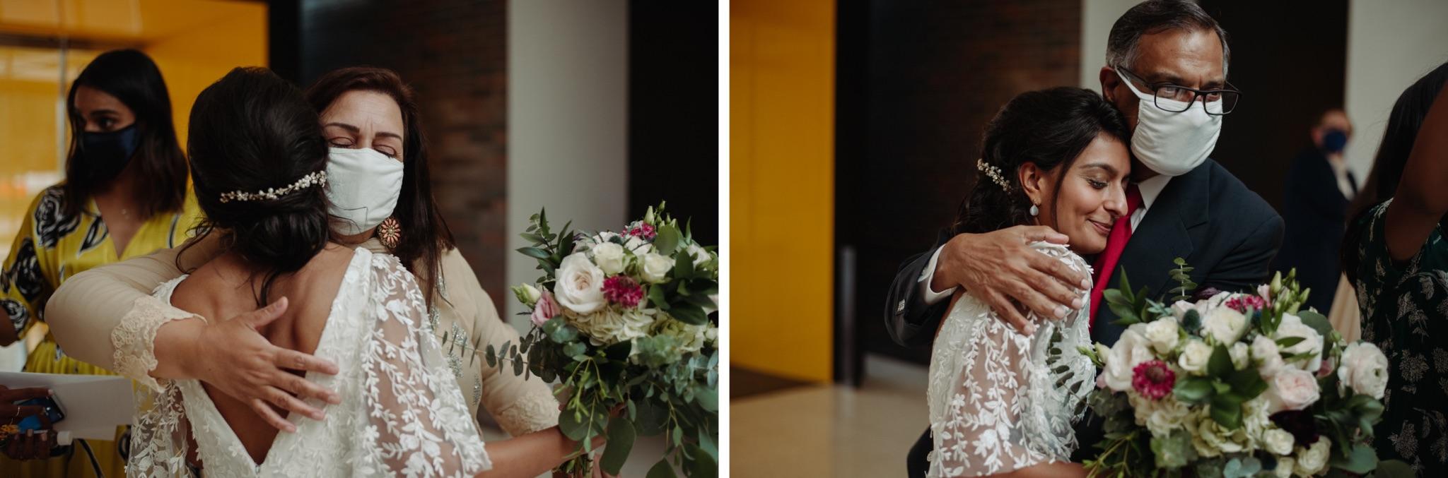 bide and dad hugging, bride and mom hugging walker art center wedding