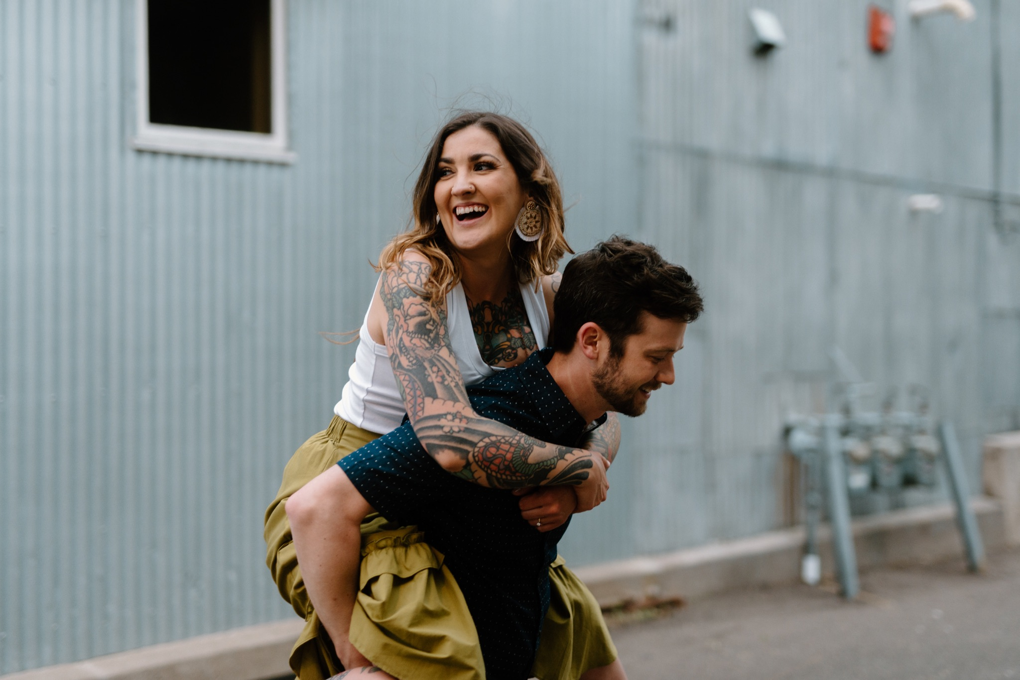 man giving woman a piggyback ride and laughing