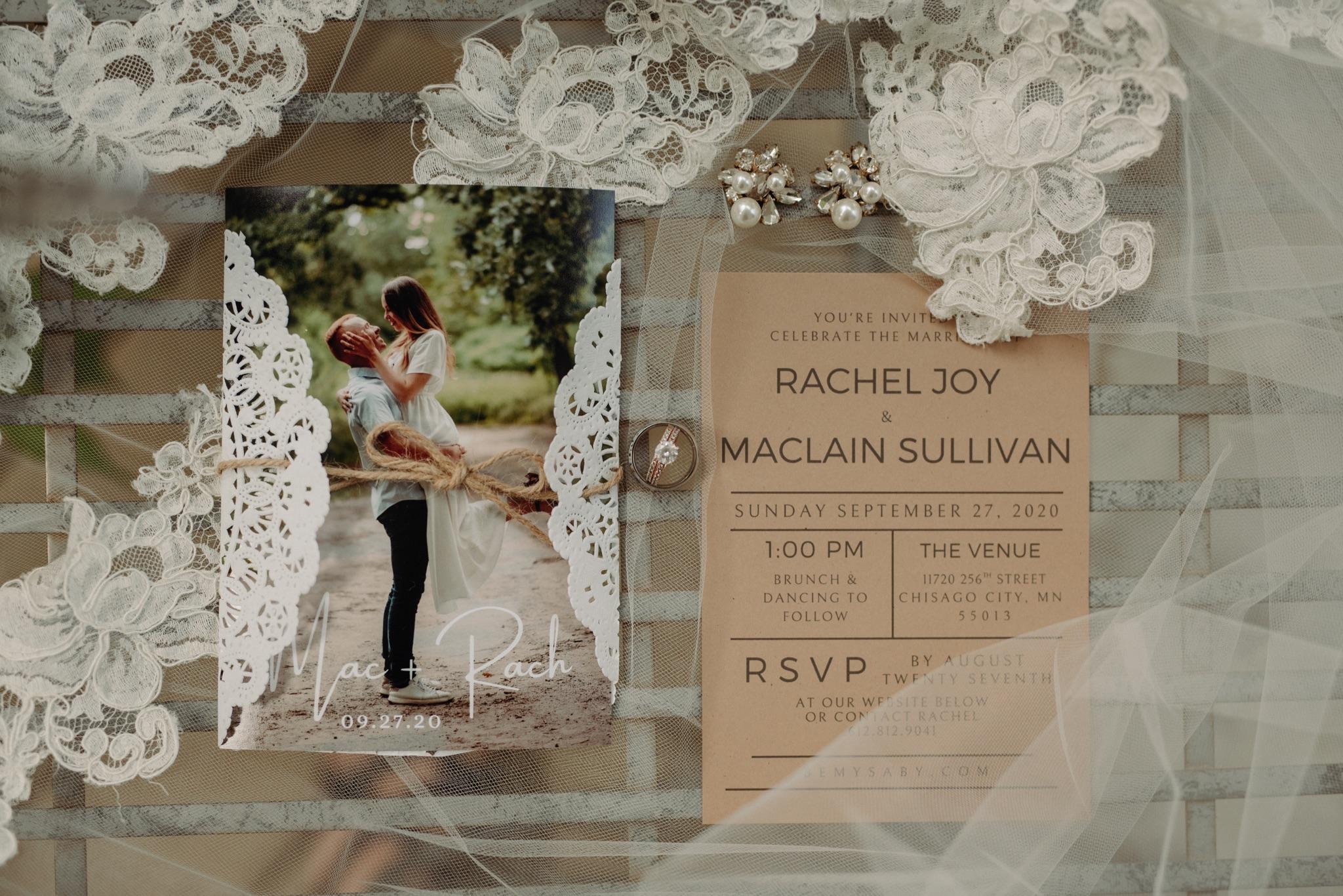 wedding invitation and wedding jewelry on lace background
