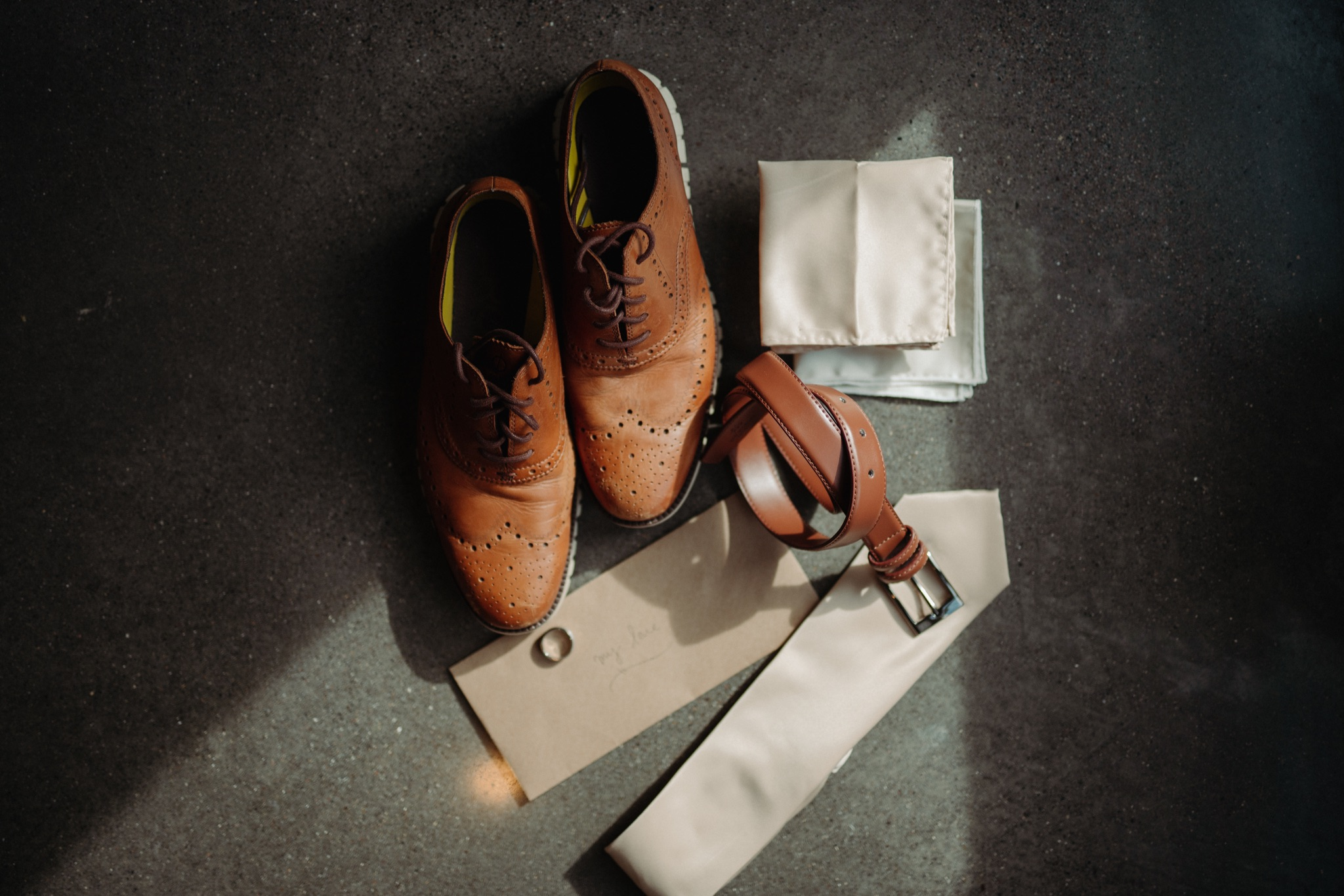 groom's shoes, ring, bent, handkerchief, tie, and letter